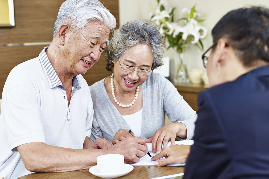 Image of older couple at a table